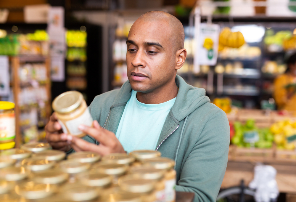Interested,Latin,American,Man,Reading,Product,Label,On,Jar,While