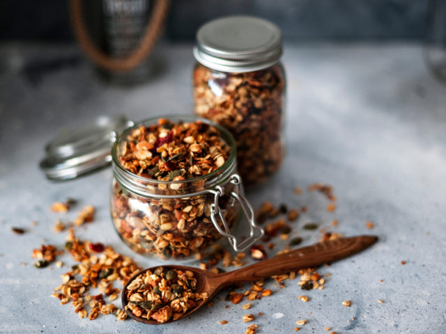Home,Granola,In,A,Glass,Jar.,Selective,Focus,,Concrete,Background.healthy