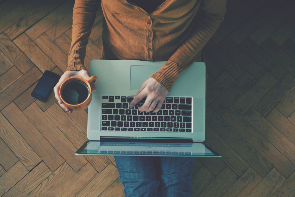 Laptop,And,Coffee,Cup,In,Girl's,Hands,Sitting,On,A
