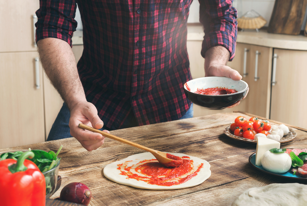 Man,Cooking,Homemade,Pizza,On,A,Wooden,Table,In,A