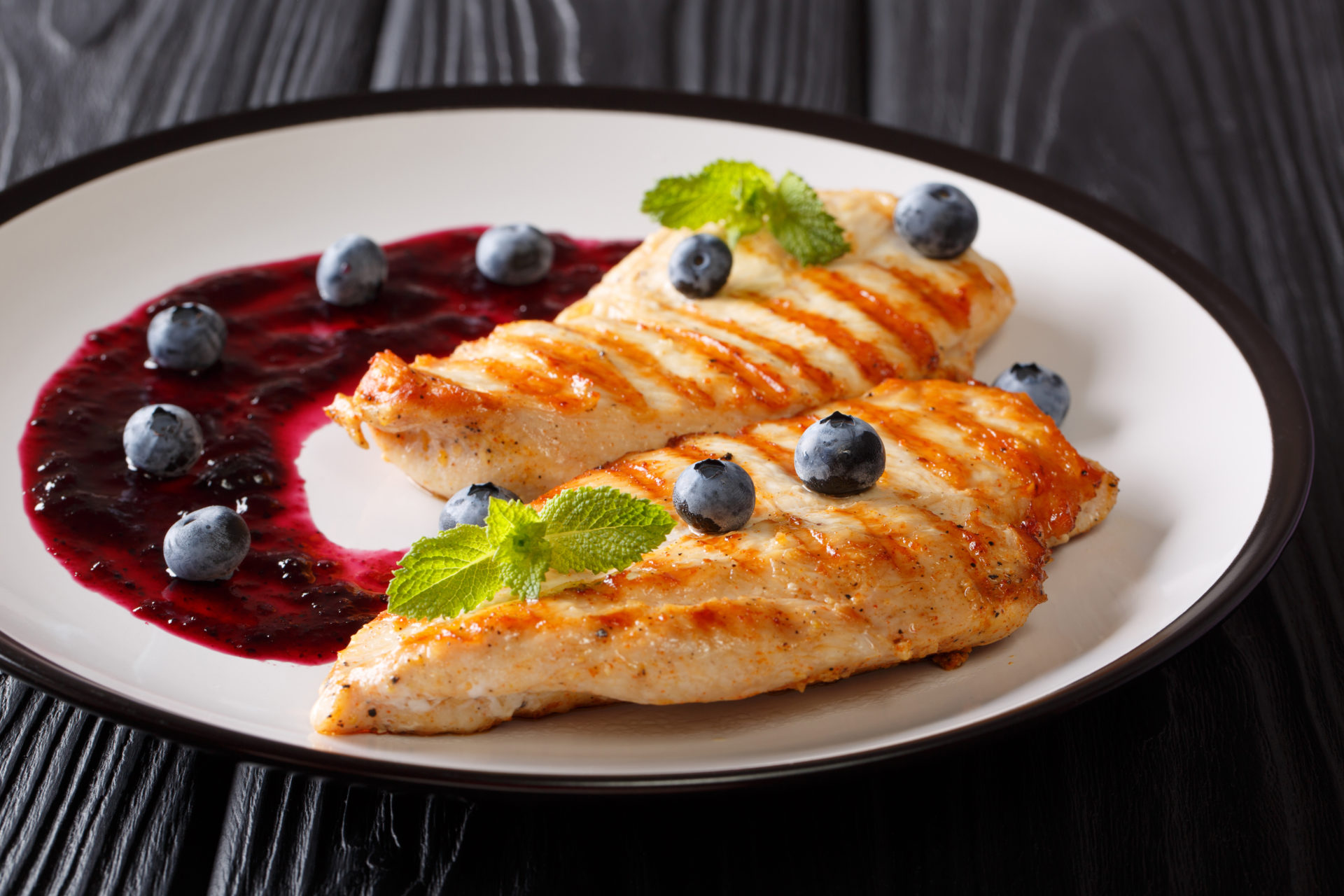 Freshly,Cooked,Grilled,Chicken,Breast,With,Berry,Sauce,And,Mint