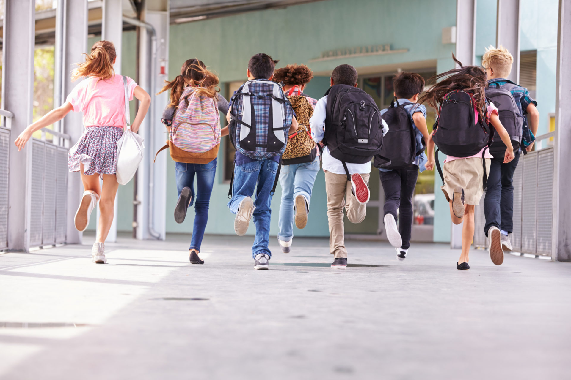 Group,Of,Elementary,School,Kids,Running,At,School,,Back,View
