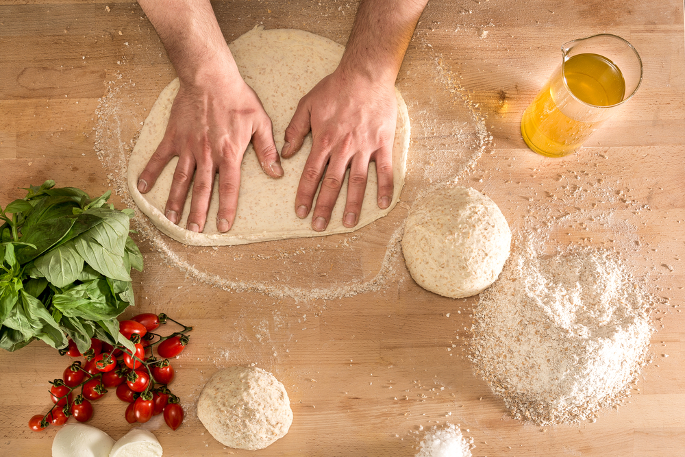 Hands,Knead,The,Dough,For,Pizza,Making
