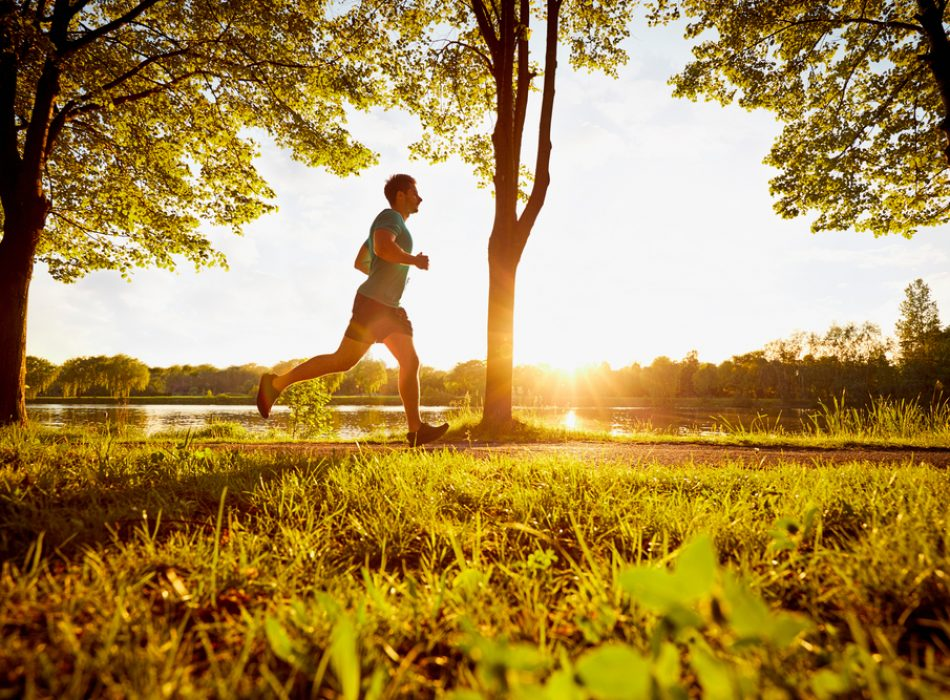 Young,Man,Running,In,Park,During,Sunset